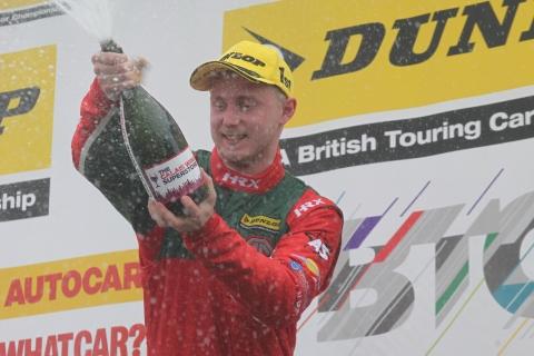 Sutton sprays champagne on the Croft podium